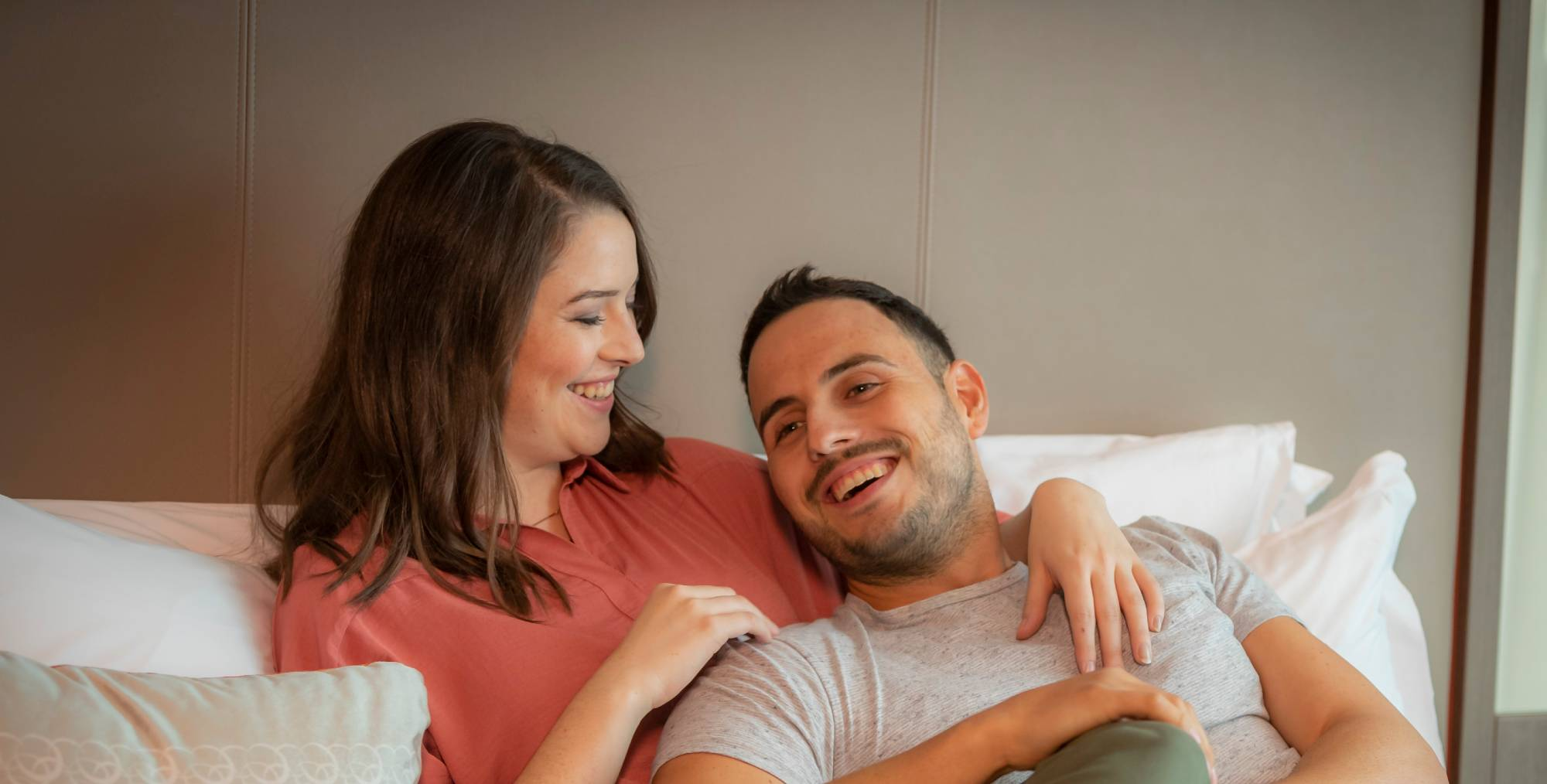 couple-relaxing-in-Clayton-Hotel-room